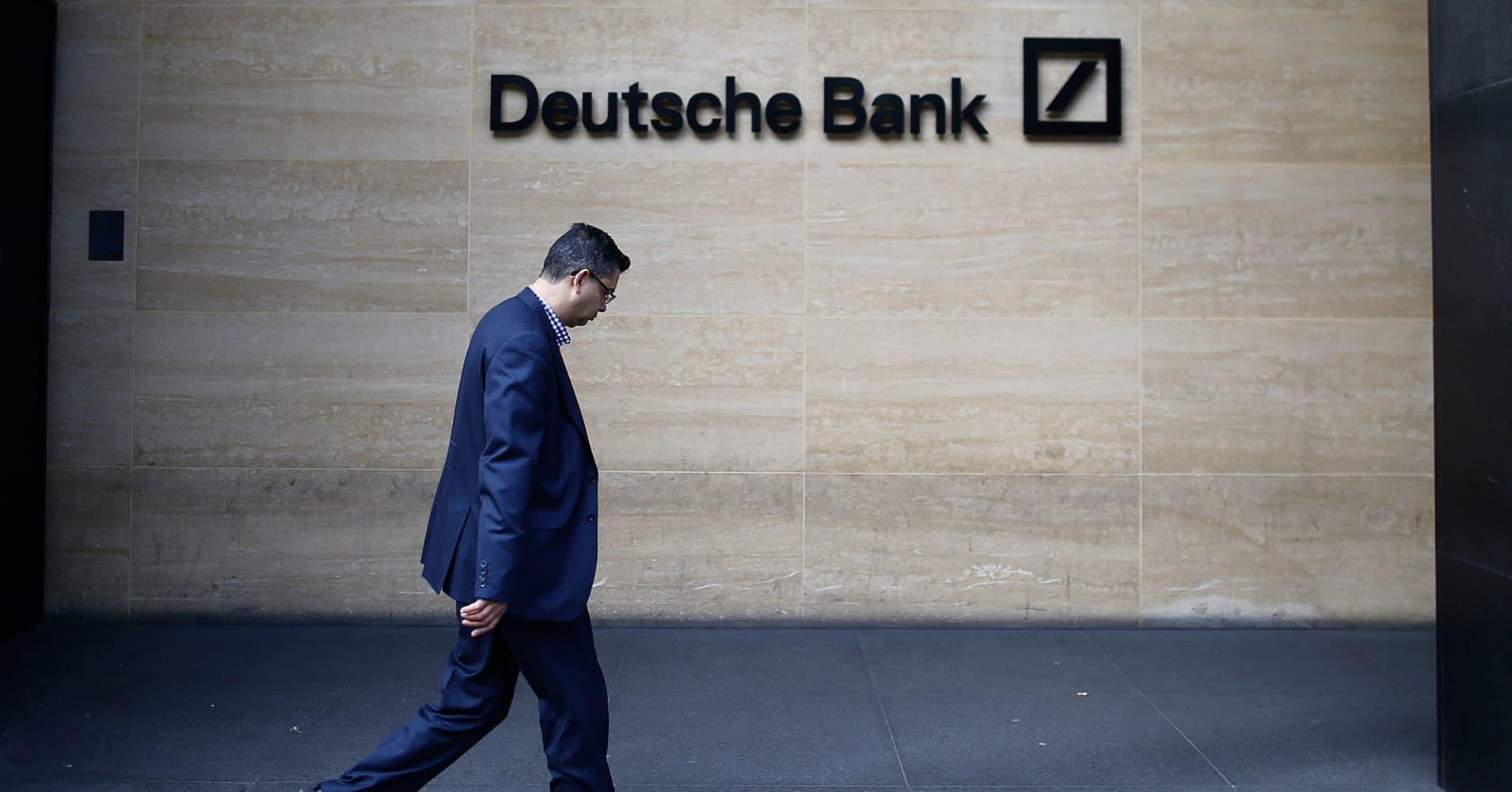 Deutsche Bank swings to first full-year net profit since 2014