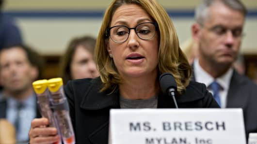Heather Bresch, chief executive officer of Mylan NV, holds up Mylan EpiPen medication while speaking during a House Oversight and Government Reform Committee hearing in Washington, D.C., U.S., on Wednesday, Sept. 21, 2016.