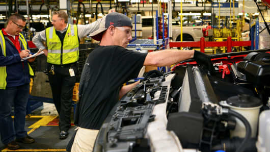 A worker assembles a Ford truck at the new Louisville Ford truck plant in Louisville, Kentucky.