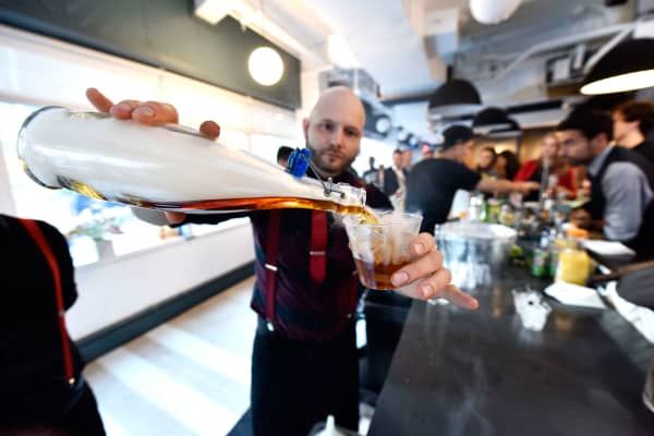 A bartender mixes drinks at the Time Out Connects party during 2016 Advertising Week New York on September 27, 2016 in New York City.