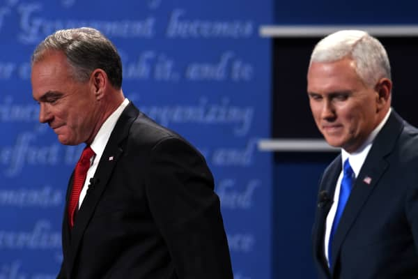 Democratic candidate for Vice President Tim Kaine (L) walks next to Republican candidate for Vice President Mike Pence after the vice presidential debate at Longwood University in Farmville, Virginia on October 4, 2016.
