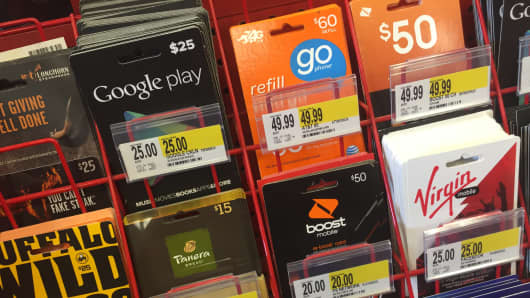 Prepaid cards on display in a grocery store in New York City.