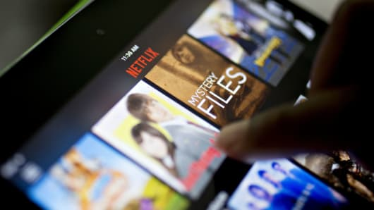 The Netflix app is demonstrated on an Apple iPad mini in Tiskilwa, Illinois.
