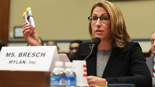 Mylan CEO Heather Bresch holds up a 2-pack of EpiPen as she testifies during a hearing before the House Oversight and Government Reform Committee September 21, 2016 in Washington, DC.