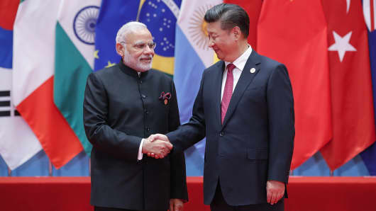 Chinese President Xi Jinping shakes hands with Indian Prime Minister Narendra Modi to the G20 Summit on September 4, 2016 in Hangzhou, China.