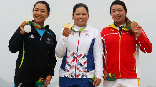 Silver medalist, Lydia Ko of New Zealand, gold medalist, Inbee Park of Korea and bronze medalist Shanshan Feng of China pose on the podium during the medal ceremony for Women's Golf on Day 15 of the Rio 2016 Olympic Games.