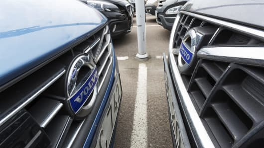 Automobiles manufactured by Volvo Car Group sit in a parking lot at the company's headquarters in Torslanda, Sweden.