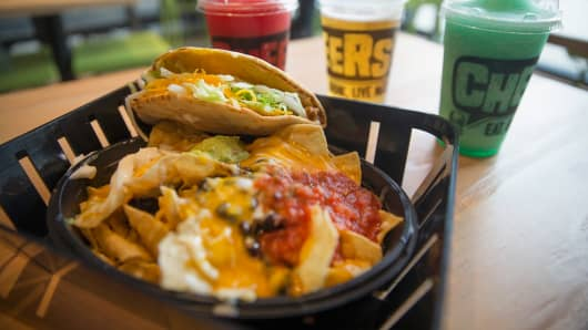 Beer and twisted Freezes are sold along with Mexican-inspired food at a Taco Bell Cantina restaurant on September 22, 2015 in Chicago, Illinois.