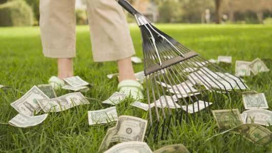 Woman raking money, property tax