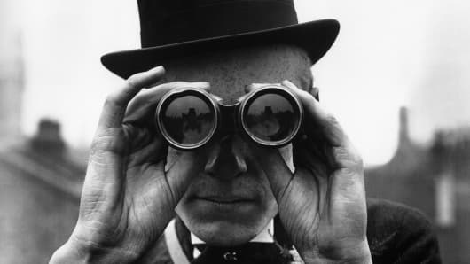 Man in top hat with binoculars, wealth