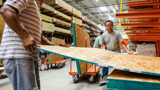 People purchasing plywood at Home Depot in Miami, Florida.