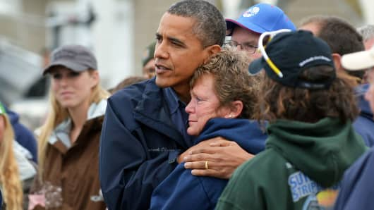 President Barack Obama comforts Hurricane Sandy victim Dana Vanzant as he visits a neighborhood in Brigantine, N.J., on Oct. 31, 2012.