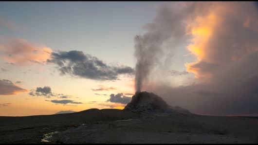 """A geyser jets up from the earth in """"Voyage of Time"""""""
