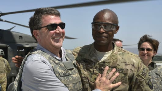 Department of Defense, then-U.S. Army Brig. Gen. Ron Lewis, right, greets then-Deputy Secretary of Defense Ash Carter, left, in Jalalabad, Afghanistan, May 13, 2013.