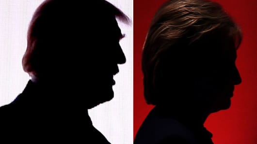 Silhouettes of Republican presidential nominee Donald Trump and Democratic presidential nominee Hillary Clinton