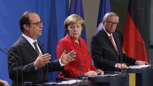 German Chancellor Angela Merkel (C), French President Francois Hollande (L) and European Commission President Jean-Claude Juncker.