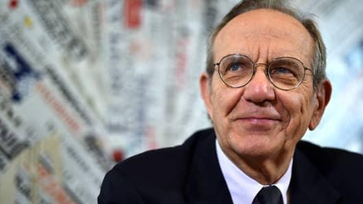 Italian Finance Minister Pier Carlo Padoan smiles.