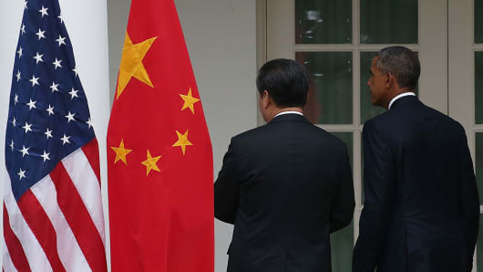 U.S. President Barack Obama (R) and Chinese President Xi Jinping leave a joint news conference in the Rose Garden at The White House on September 25, 2015 in Washington, DC.