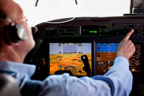 A pilot activates an infrared display in the cockpit of a Gulfstream jet during a Honeywell International prototype technology demonstration.