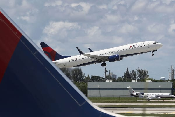 A Delta airlines plane is seen as it takes off at the Fort Lauderdale-Hollywood International Airport.