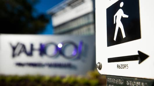 A pedestrian street crossing sign stands at Yahoo headquarters in Sunnyvale, California.