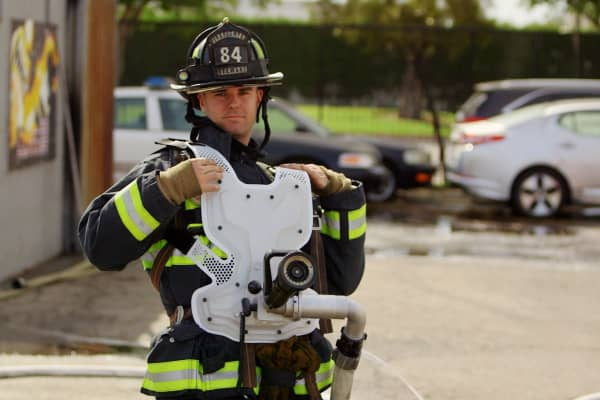 A firefighter tries on the latest iteration of the Aqua Blaster.