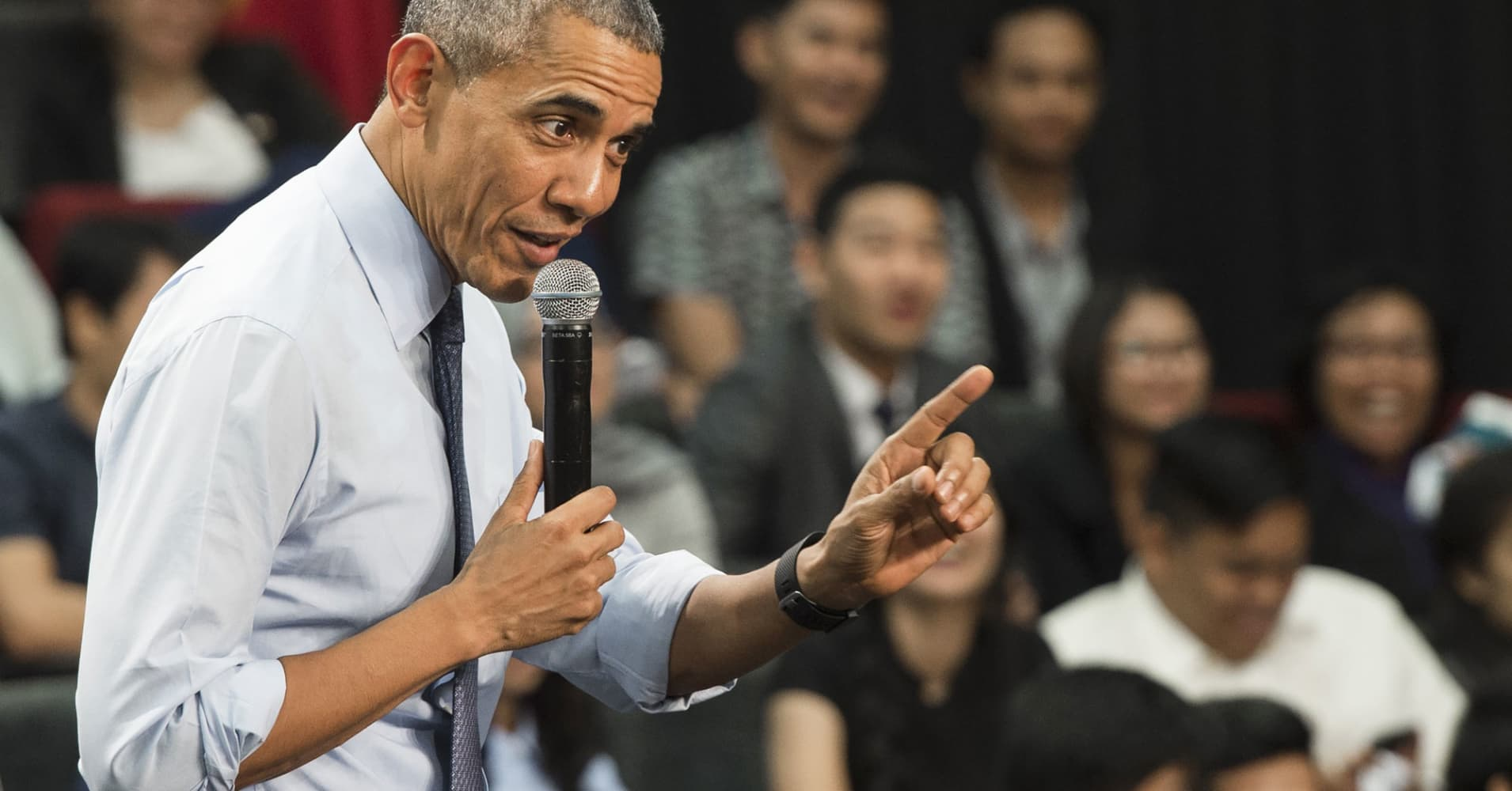 President Barack Obama answers a question during a town hall.