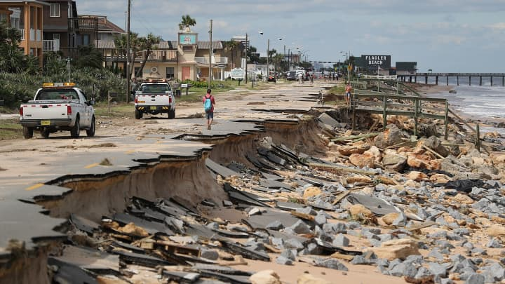 A1A is seen after ocean waters stirred up by Hurricane Matthew washed away part of the ocean front road on October 8, 2016 in Flagler Beach, Florida.