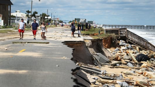 A1A is seen after ocean waters stirred up by Hurricane Matthew washed away the ocean front road in Flagler Beach, Florida.