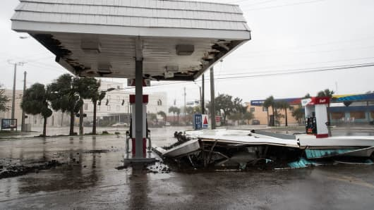 A view of a collapsed roof at a gas station after Hurricane Matthew passes through on October 7, 2016 in Daytona Beach, Florida.