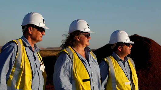 Billionaire Gina Rinehart (C), chairman of Hancock Prospecting, during a tour of the company's Roy Hill Mine in Western Australia.