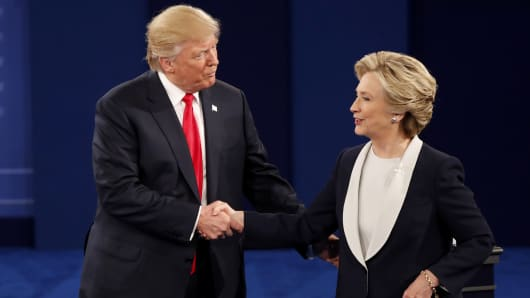 Republican U.S. presidential nominee Donald Trump and Democratic U.S. presidential nominee Hillary Clinton shake hands at the conclusion of their presidential town hall debate at Washington University in St. Louis on Oct. 9, 2016.