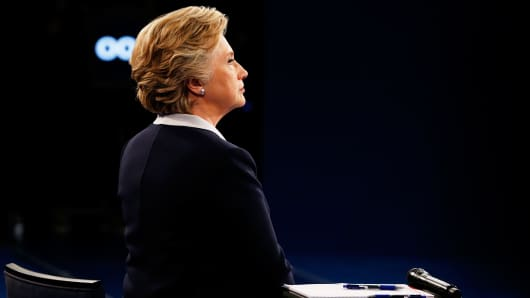 Democratic presidential nominee former Secretary of State Hillary Clinton listens during the town hall debate at Washington University on October 9, 2016 in St Louis, Missouri.