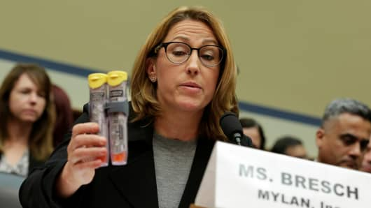Mylan NL CEO Heather Bresch holds EpiPens during a House Oversight and Government Reform Committee hearing on the Rising Price of EpiPens at the Capitol in Washington, U.S., September 21, 2016.