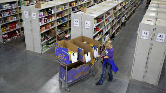 An employee assembles customer orders at the Jet.com Inc. fulfillment center on Cyber Monday in Kansas City, Kan.