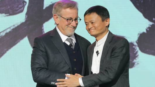 Steven Spielberg (L), American director and chairman of Amblin Partners, and Jack Ma, chairman and chief executive of Alibaba Group, attend strategy conference to announce partnership between the two companies on October 9, 2016 in Beijing, China.