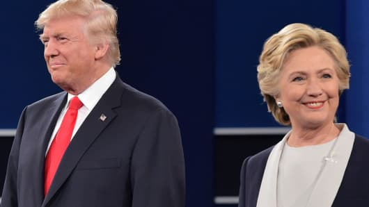 Democratic presidential candidate Hillary Clinton (R) and US Republican presidential candidate Donald Trump at the second presidential debate at Washington University in St. Louis, Missouri, on October 9, 2016.