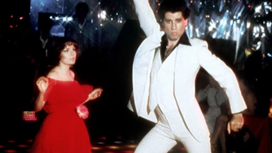 Actor John Travolta dances with Karen Lynn Gorney in scene from movie 'Saturday Night Fever.'