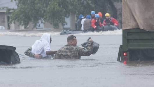 North Carolina Army National Guardsmen and local emergency services assist with evacuation efforts.