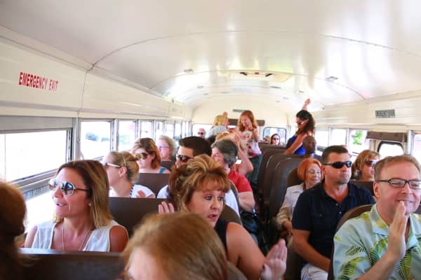 Passengers riding on a Detroit Bus Company tour help fund rides for children in need. The low-profit limited liability company donates a portion of tour proceeds to that cause.