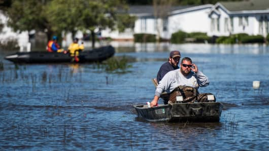 Residents and rescue teams navigate floodwaters on October 10, 2016 in Lumberton, North Carolina.