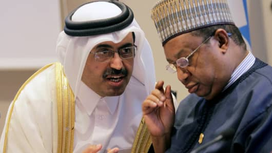 2016Organization of Petroleum Exporting Countries (OPEC) President, Qatar's Minister of Energy Mohammed bin Saleh al-Sada speaks with Secretary General of OPEC Mohammed Sanusi Barkindo (R), during a news conference after an informal meeting between members of the organization in Algiers, Algeria September 28, 2016.