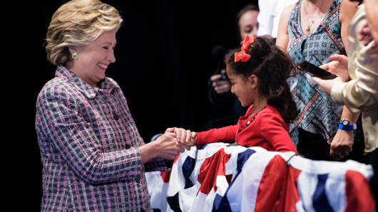 Democratic presidential nominee Hillary Clinton greets a young girl during a rally