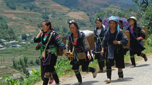 A May 2014 photograph shows H'mong women in Sapa in the northern Vietnamese province of Lao Cai. Lo Cai has a safe-hous