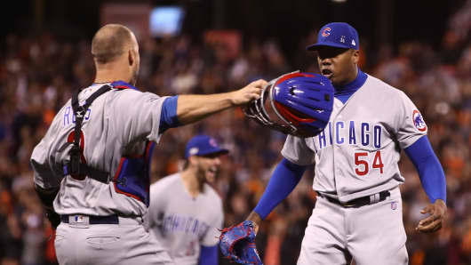 avid Ross #3 and Aroldis Chapman #54 of the Chicago Cubs celebrate after defeating the San Francisco Giants 6-5 in Game Four of their National League Division Series to advance to the National League Championship Series at AT&T Park on October 11, 2016 in San Francisco, California.