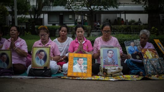 Thai Royalists holds several portraits of Thailand's King Bhumibol Adulyadej at Siriraj Hospital.