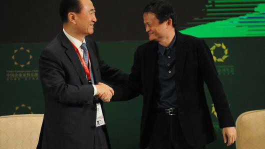Wang Jianlin (L), Chairman of the Dalian Wanda Group and Jack Ma, Executive Chairman of Alibaba Group top Hurun Report's China Rich List.