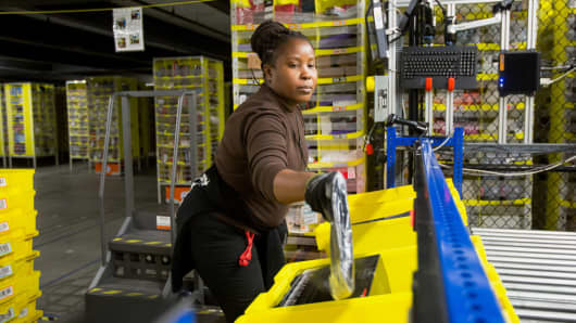An employee works in an Amazon.com fulfillment center in Robbinsville, New Jersey.