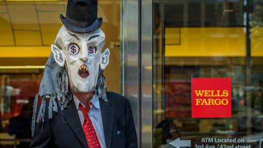 A protester outside a Wells Fargo branch in New York City.