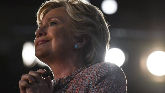 Democratic presidential candidate Hillary Clinton pauses while speaking during a rally.